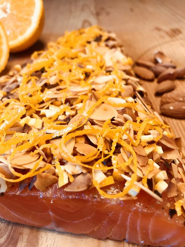 Graved salmon with roasted almonds and orange zest