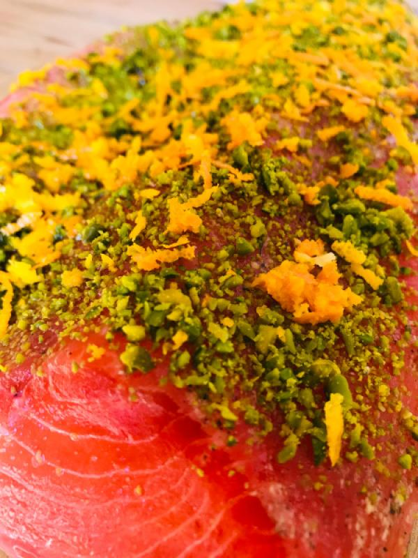 Stained (graved) salmon trout with gin, pistachio and orange zest