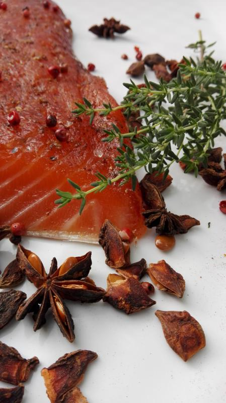 Salmon marinated with brown sugar, pink berries and star anise