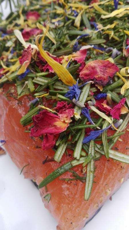 Salmon marinated with rosemary, dill and flower mix
