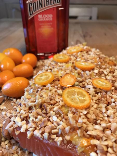 Graved salmon with blood-orange cointreau, roasted almonds and kumquats