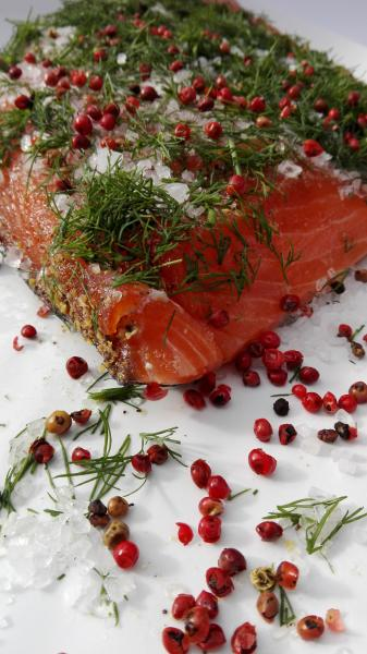 Salmon marinated with dill and pink berries