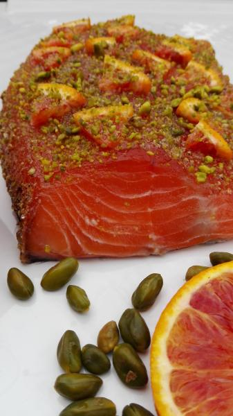 Salmon marinated with gin, blood orange and pistachios