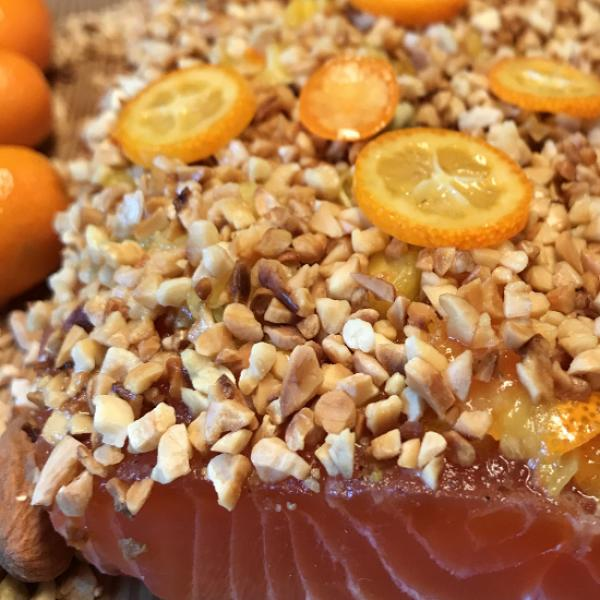 Graved salmon with roasted almonds and kumquats